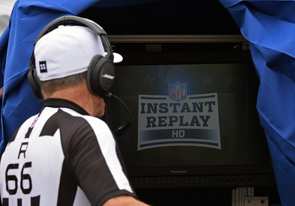 PITTSBURGH, PA - SEPTEMBER 28:  National Football League referee Walt Anderson #66 looks at the monitor in the instant replay booth used to review challenged plays during a game between the Tampa Bay Buccaneers and the Pittsburgh Steelers at Heinz Field on September 28, 2014 in Pittsburgh, Pennsylvania.  The Buccaneers defeated the Steelers 27-24.  (Photo by George Gojkovich/Getty Images)
