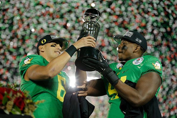 January 1, 2015: Oregon Ducks quarterback Marcus Mariota (8) and Oregon Ducks linebacker Tony Washington (91) holds The Leishman Trophy after the College Football Playoff Semifinal Rose Bowl Game presented by Northwestern Mutual between the Florida State Seminoles and the Oregon Ducks at the Rose Bowl in Pasadena, CA. (Photo by Ric Tapia/Icon Sportswire/Corbis via Getty Images)
