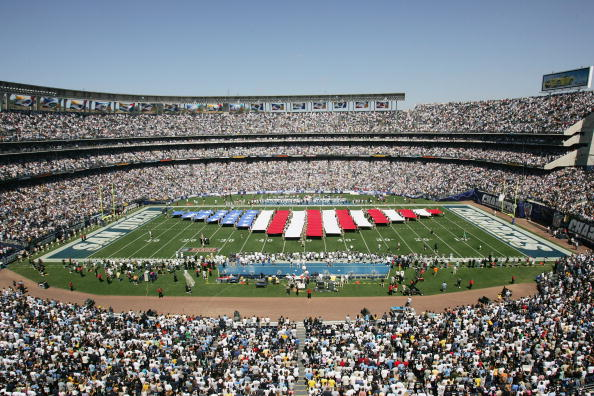 SAN DIEGO - SEPTEMBER 11: Banners symbolic of the American flag are unfurled on the field before the game between the San Diego Chargers and the Dallas Cowboys on September 11, 2005 at Qualcomm Stadium in San Diego, California. The Cowboys won 28-24. (Photo by Stephen Dunn /Getty Images)