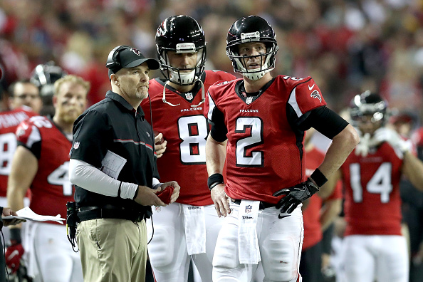 ATLANTA, GA - JANUARY 22: Head coach Dan Quinn of the Atlanta Falcons looks on with quarterback Matt Ryan #2 in the third quarter against the Green Bay Packers  in the NFC Championship Game at the Georgia Dome on January 22, 2017 in Atlanta, Georgia.  (Photo by Rob Carr/Getty Images)