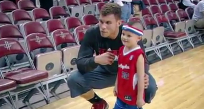 Blake Griffin with Justice Griffith and the shoes they designed together.