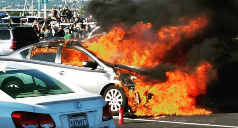 A fire in the parking lot at the Oakland A's game.