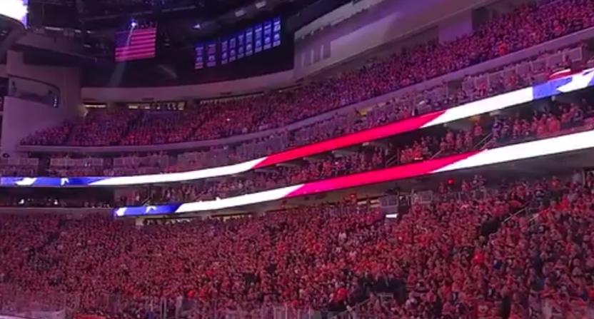 The Edmonton Oilers' crowd sings the U.S. anthem.