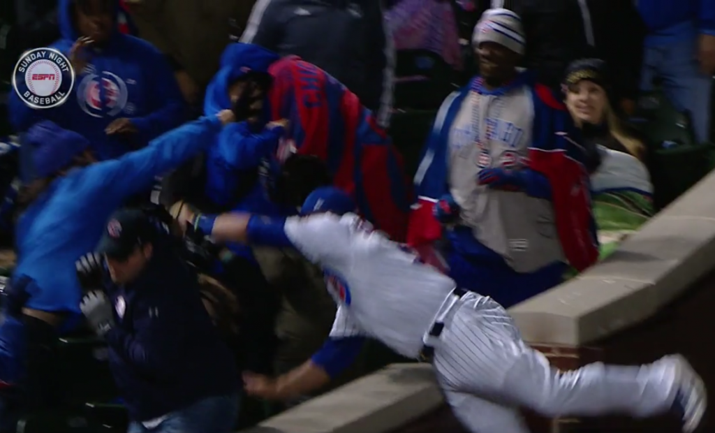 The Cubs' Kyle Schwarber went over a wall to make this catch.