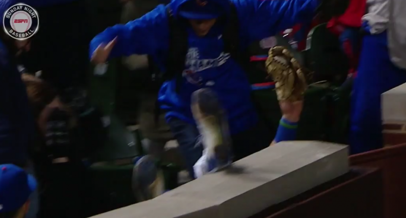 Kyle Schwarber somehow kept the ball in his glove.