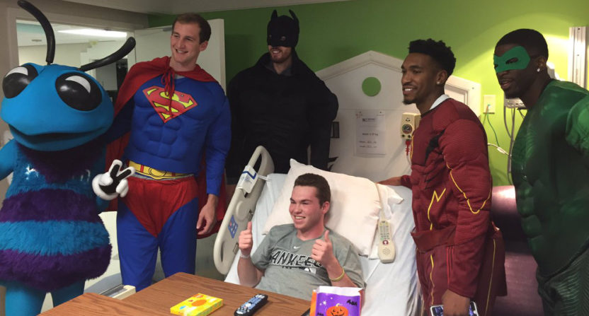 Charlotte Hornets players dressed as superheroes for a visit to a children's hospital.