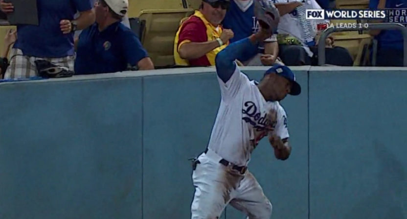 Yasiel Puig slammed his glove hard after diving for and missing a fly ball.