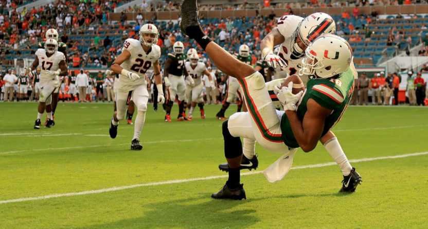 Lawrence Cager's touchdown grab helped Miami outlast Virginia Saturday.