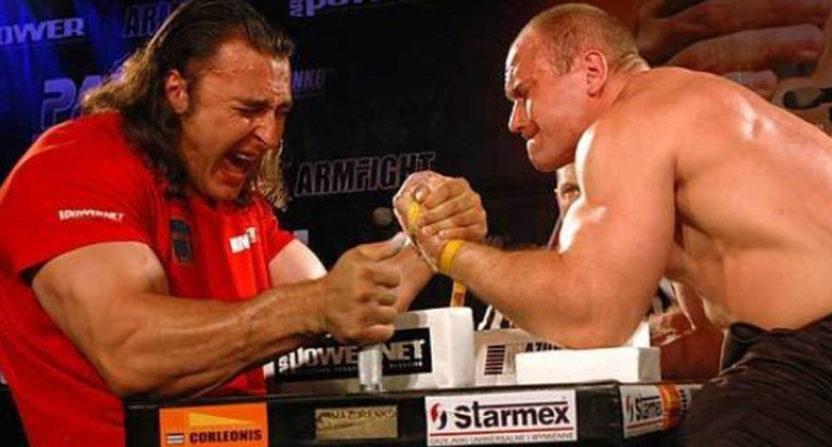 Russian arm wrestler Alexey Voyedova (L) trains against Denis Tsyplenkov.