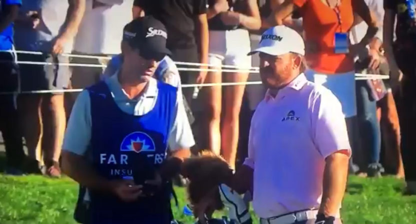 J.B. Holmes talks a shot over with caddy Brandon Parsons.