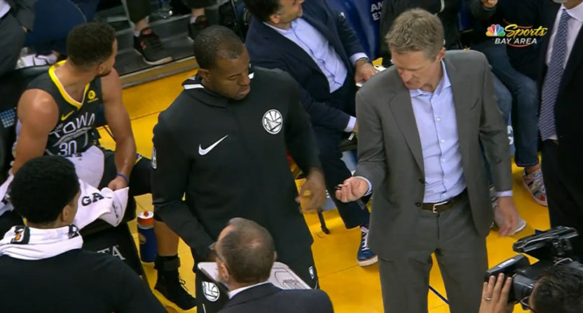 Steve Kerr hands the clipboard off to Andre Iguodala.