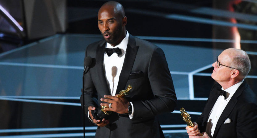 Kobe Bryant and Glen Keane with their Oscars.