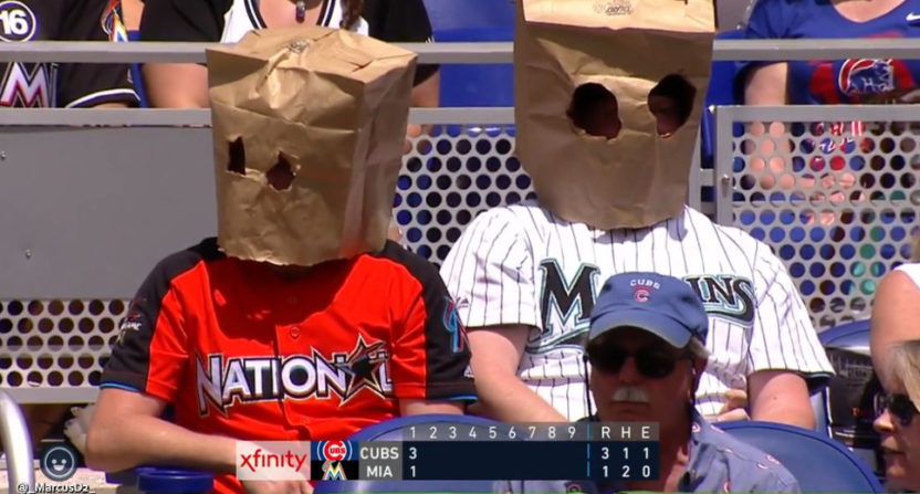 Marlins' fans wearing bags on their heads.