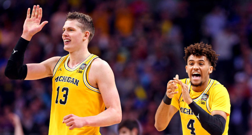 Michigan players Moritz Wagner (L) and Isaiah Livers celebrate against Loyola-Chicago.