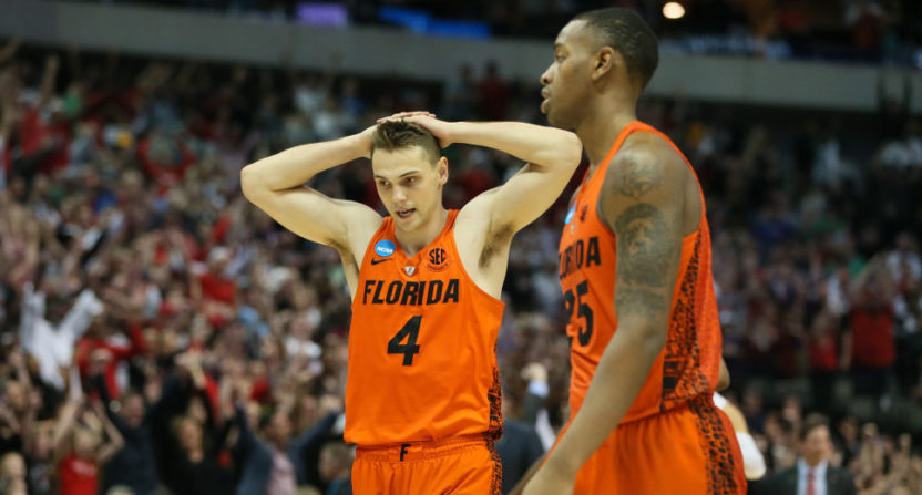 Florida players Egor Koulechov (4) and forward Keith Stone (25) dismayed after a loss to Texas Tech.