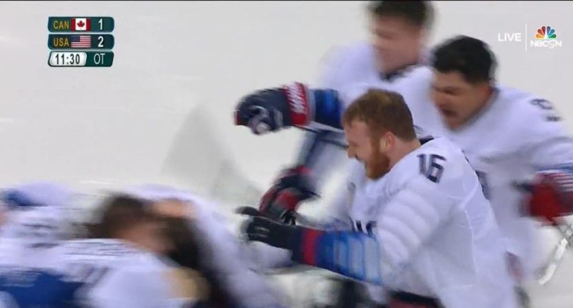 Declan Farmer and his teammates celebrate Paralympic ice hockey gold.