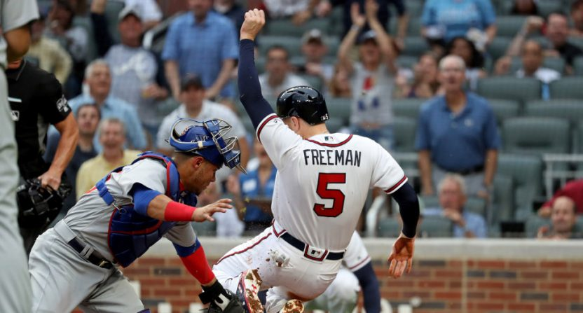 Cubs' catcher Willson Contreras tagged Freddie Freeman out at the plate after an erroneous earlier throw.
