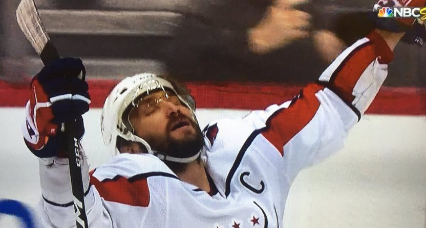 Alex Ovechkin celebrates the Caps' OT win that eliminated the Pens.