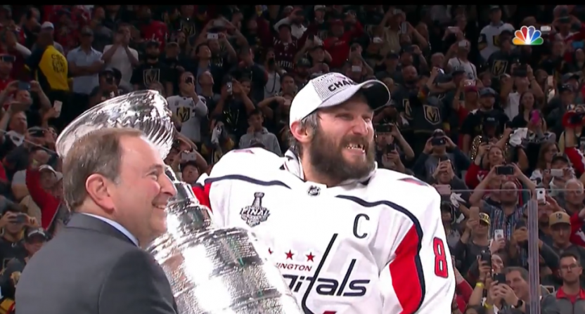 Alex Ovechkin lifts the Stanley Cup.