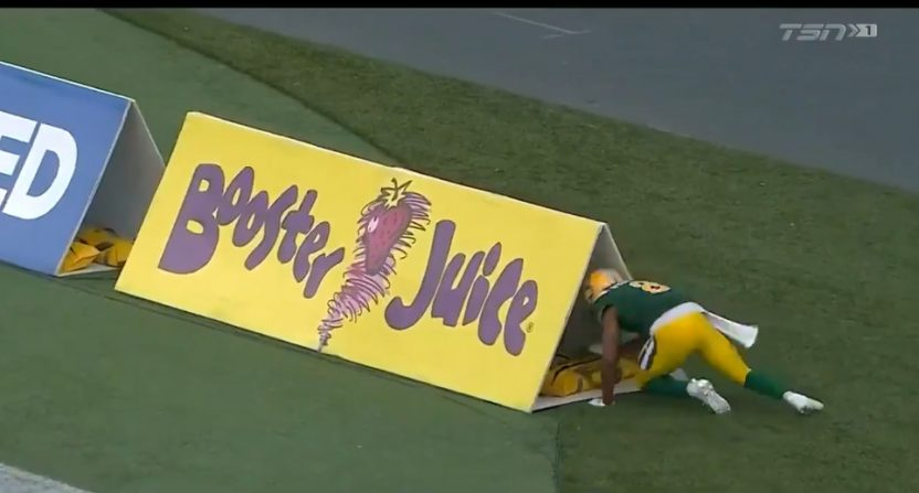 Duke Williams was penalized for crawling through this sign. Under a new CFL rule, he wouldn't be.