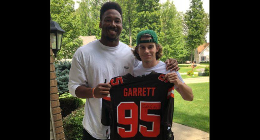 Myles Garrett giving a fan a jersey.