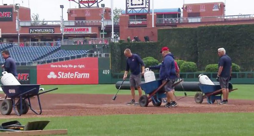 Flamethrowers were used to try and dry Citizens Bank Park Monday.