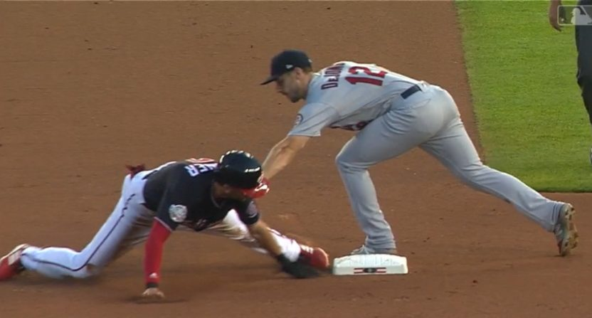 Trea Turner was called out after trying to advance on a walk.