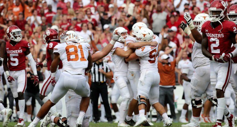 Texas kicker Cameron Dicker and his teammates celebrate their win over Oklahoma.
