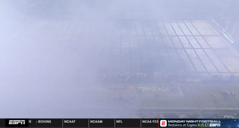 The Boise State field screened by smoke.