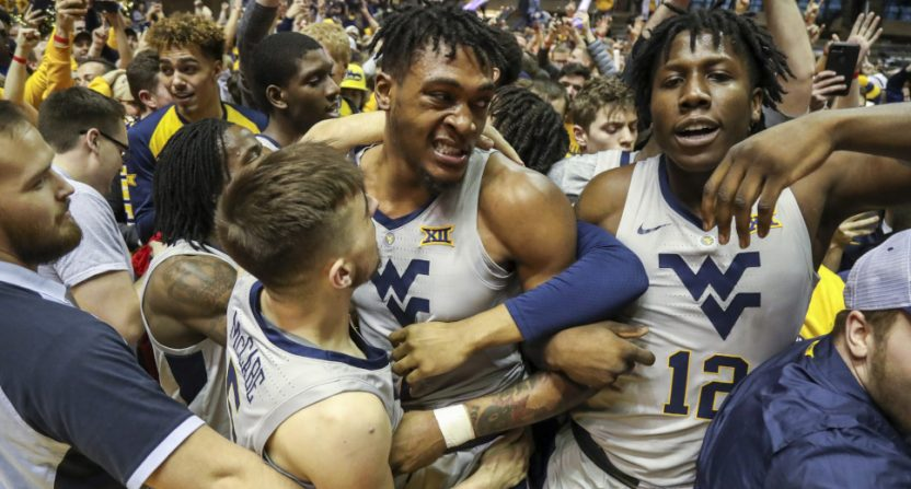 West Virginia players celebrating a win over Kansas.