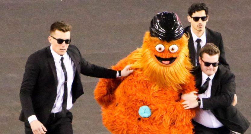Flyers' mascot Gritty detained by security at the Stadium Series.
