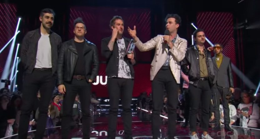 The Arkells claiming their Juno Group of the Year award.