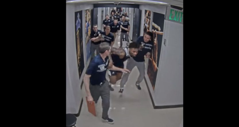 Nevada's Jordan Caroline running down the hallway after their loss to Utah State.