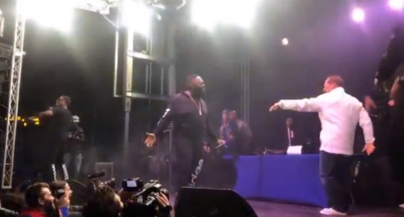 Les Miles on stage with Rick Ross.