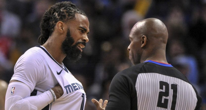 Mike Conley Jr. talks to referee David Guthrie during a March 27, 2019 game.