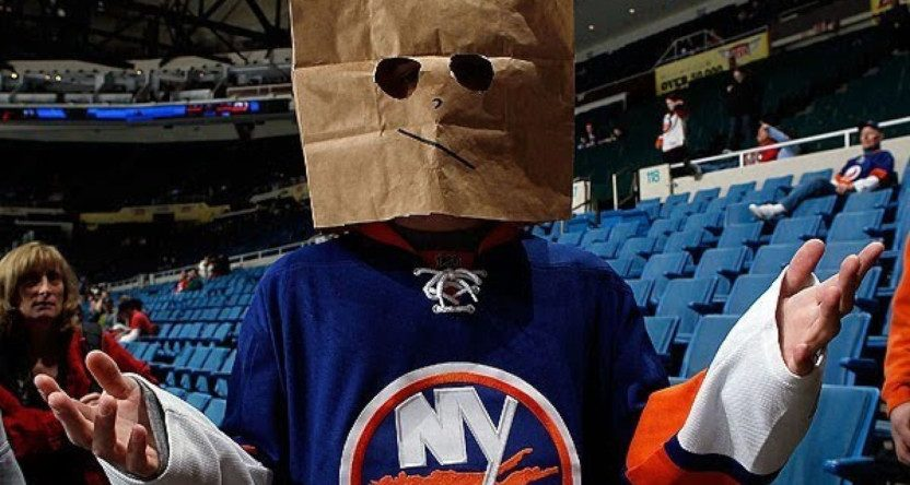 An Islanders' fan with a bag on his head.