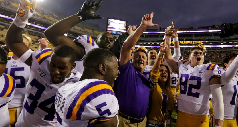 LSU players and HC Ed Orgeron celebrating a win against Auburn.