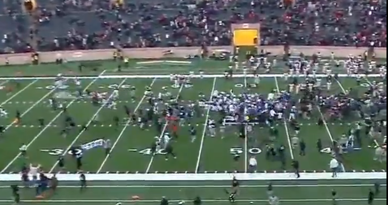 Yale students storm the field after beating Harvard.
