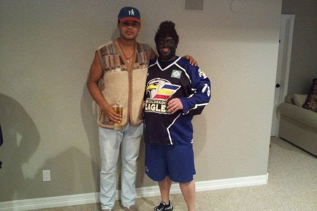 "Akim Aliu with Tony Deynzer, who dressed as Aliu in blackface to ""surprise him"" at a 2011 Christmas party."
