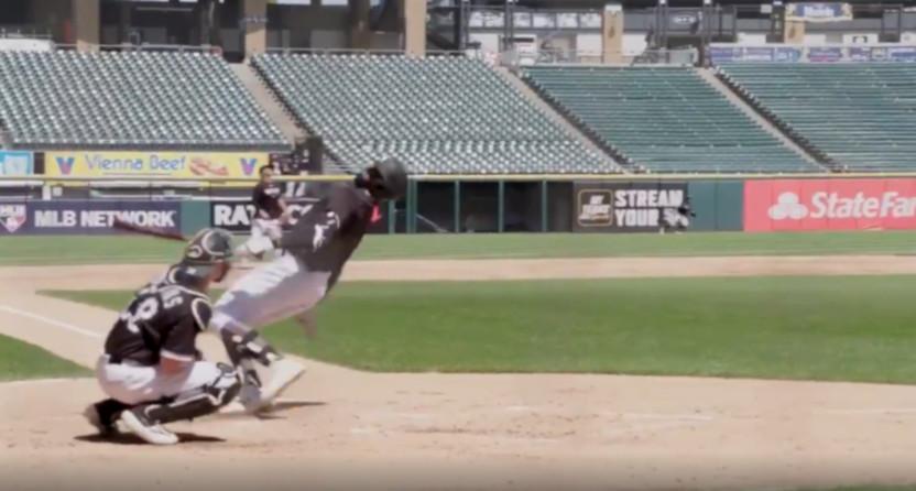 Luis Robert hits a home run while falling.