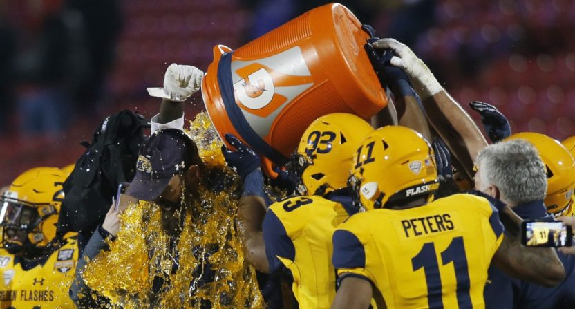 Kent State players dunk head coach Sean Lewis after their 2019 Frisco Bowl win.