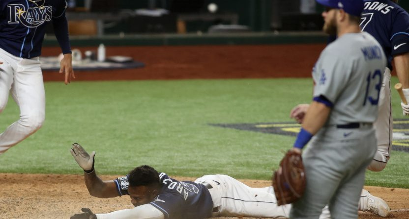 The Rays' Randy Arozarena scores against the Dodgers.