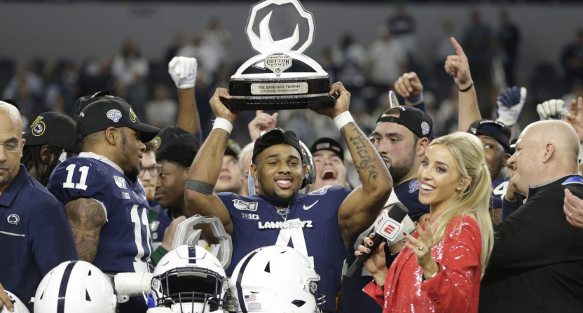 Journey Brown with the outstanding offensive player trophy after the 2019 Cotton Bowl.