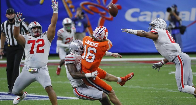 Ohio State defensive linemen Tyreke Smith (11, sacking Clemson QB Trevor Lawrence) and Tommy Togiai (#72) against Clemson on Jan. 1.