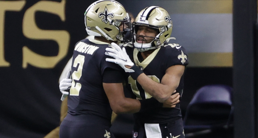 Saints' players Jameis WInston and Tre'Quan Smith celebrate a touchdown against the Bucs.
