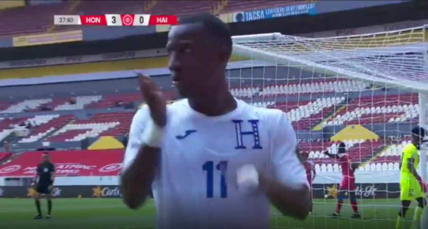 Honduras' Darixon Vuelto celebrates scoring against Haiti.