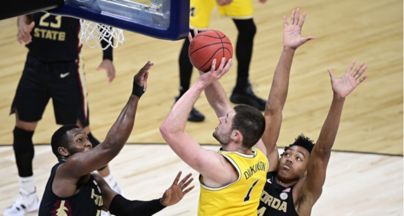 Michigan center Hunter Dickinson shoots against Florida State.