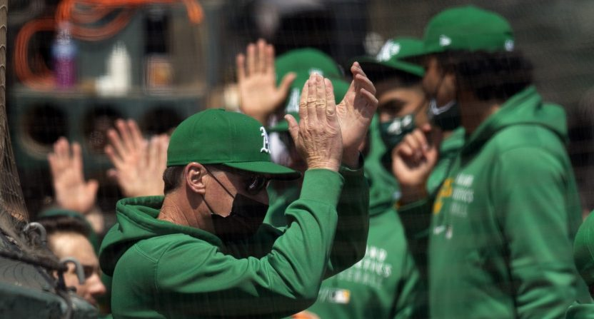 A's manager Bob Melvin with his team on April 21.
