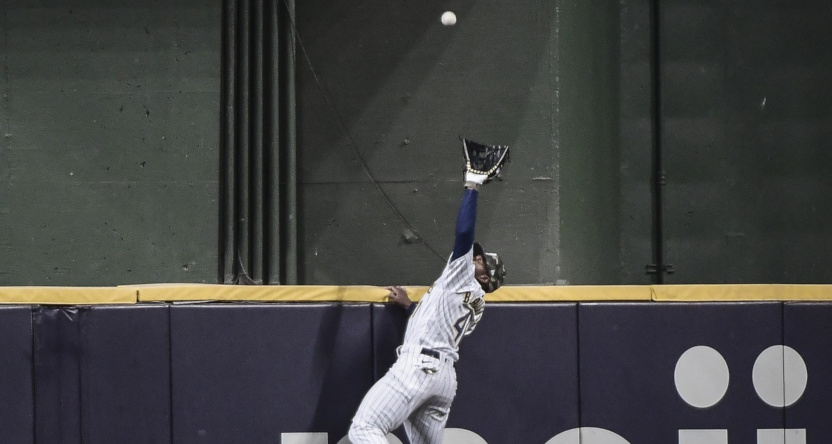 Jackie Bradley Jr. with a grab at the wall against the Braves Saturday.
