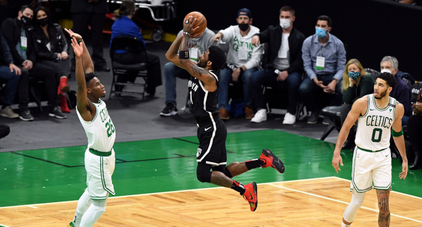 The Nets' Kyrie Irving driving against the Celtics.